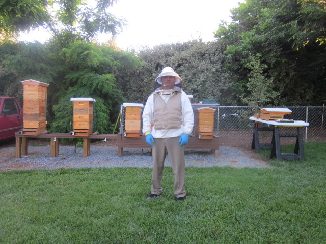 Man in Bee Keeper outfit wearing Kool Max adjustable zipper front cooling vest