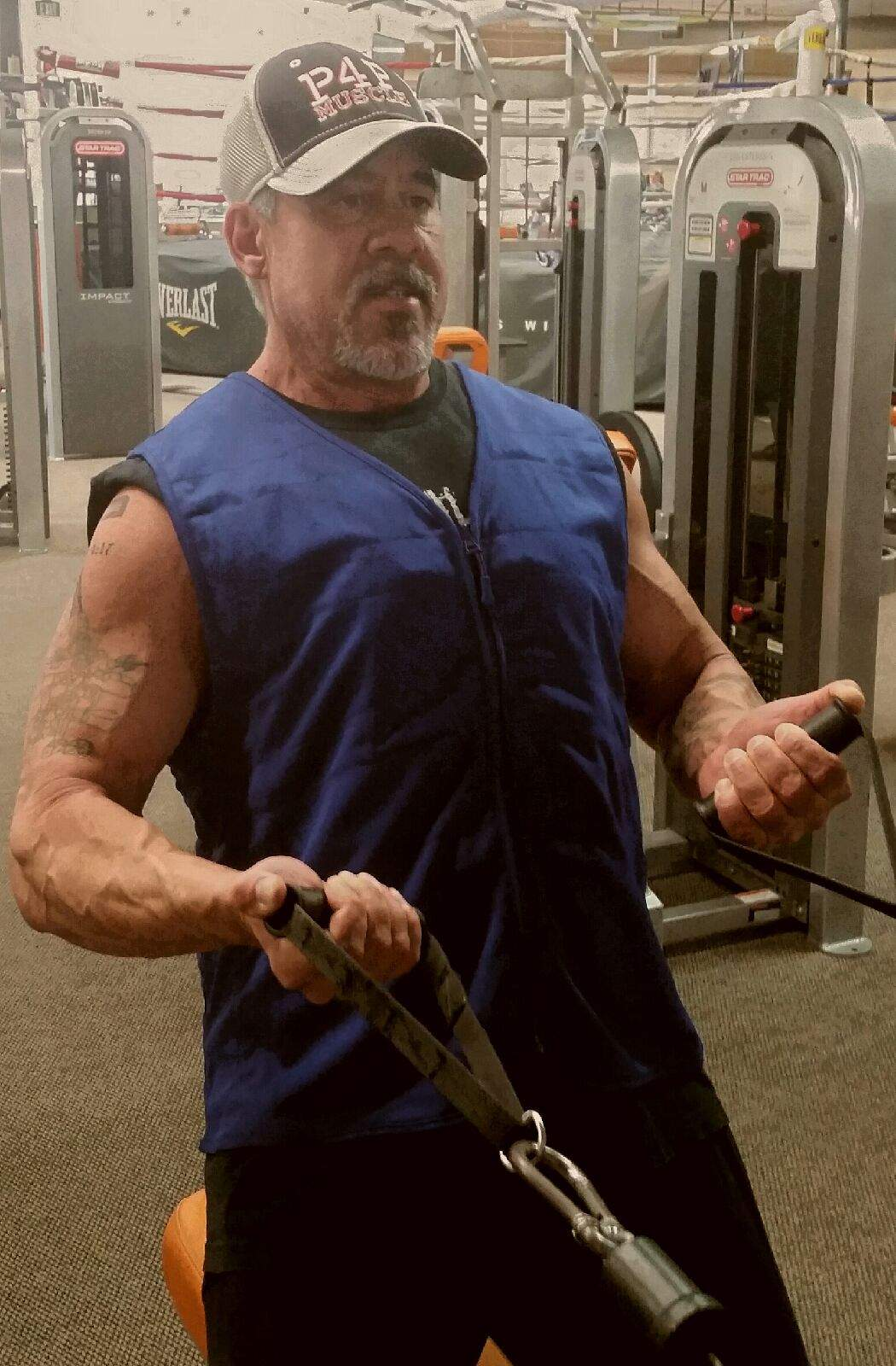 Man working out wearing a Cool Comfort deluxe sports vest