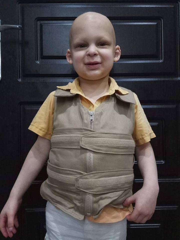 Boy wearing a khaki cool kids cooling vest