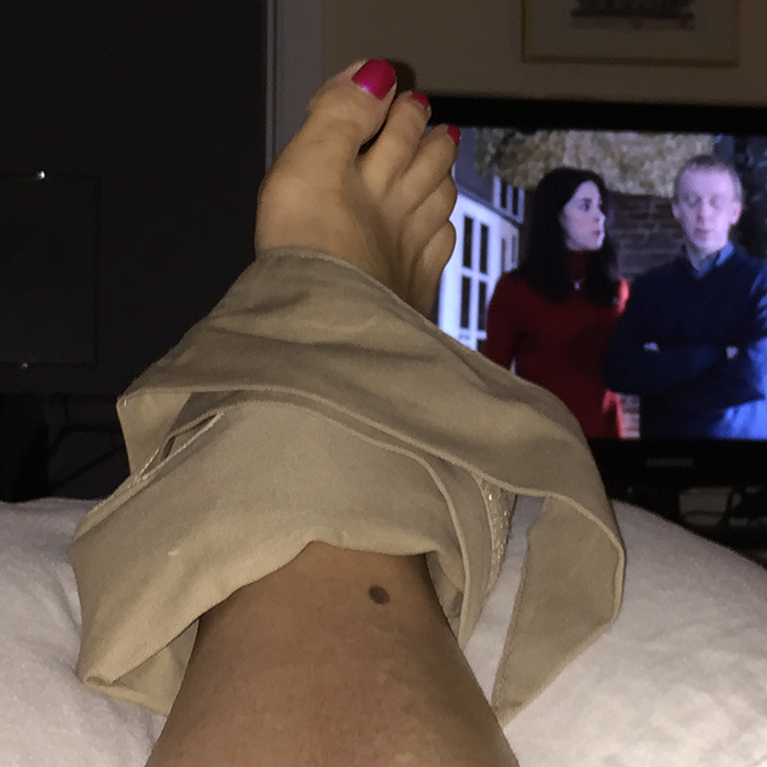 Woman with a Soft Ice foot and ankle wrap around her ankle