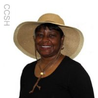 Woman wearing a khaki straw hat with a cool comfort evaporative cooling insert