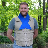 Man wearing khaki adjustable zipper front cooling vest with blue cooling neck wrap