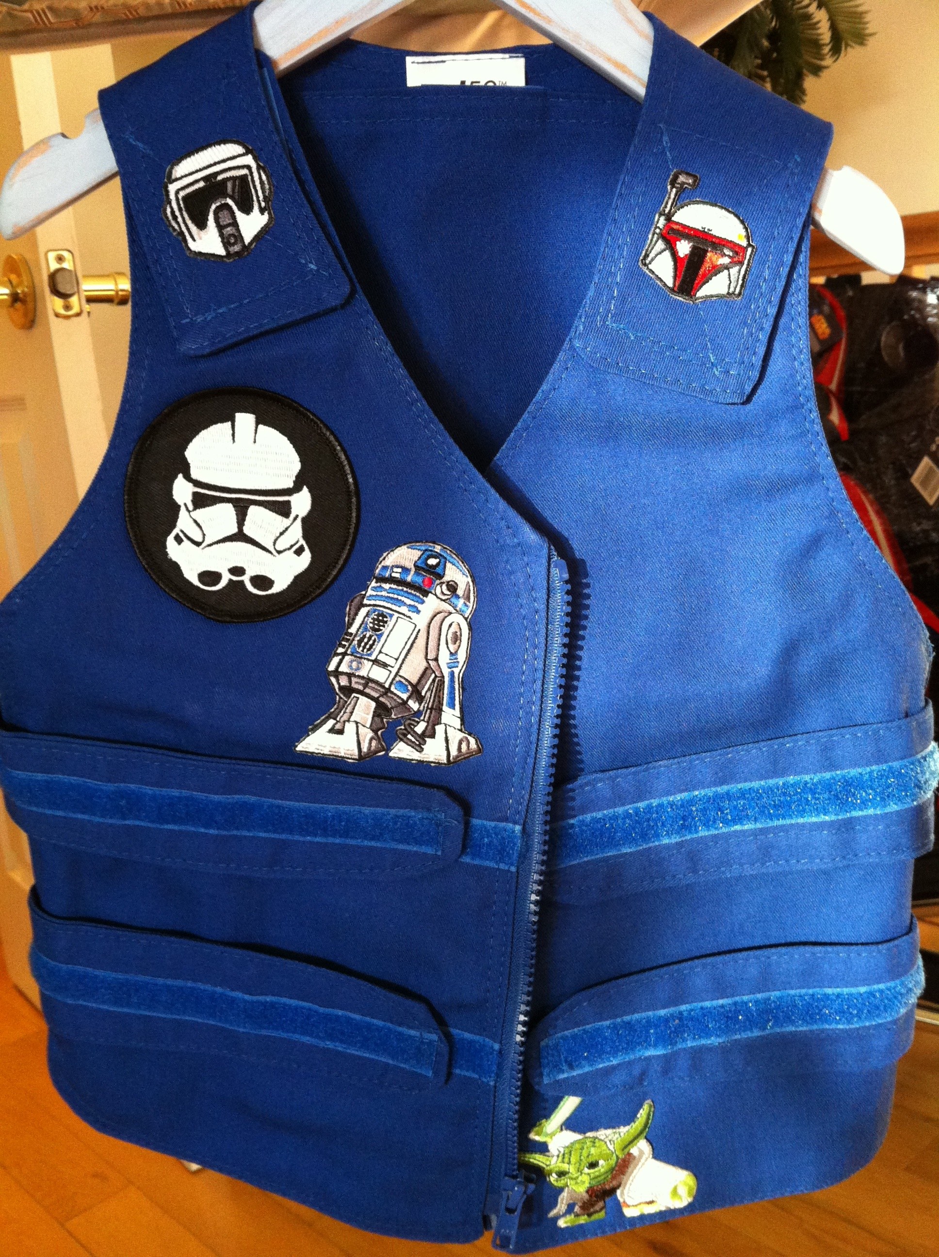Blue Cool Kids toddlers cooling vest with star wars patches sewn on