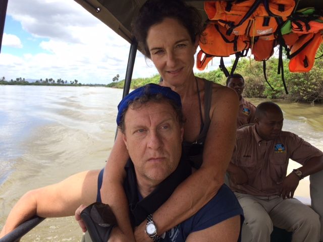 Man wearing a cool comfort cooling bandana with a woman in a boat on a river