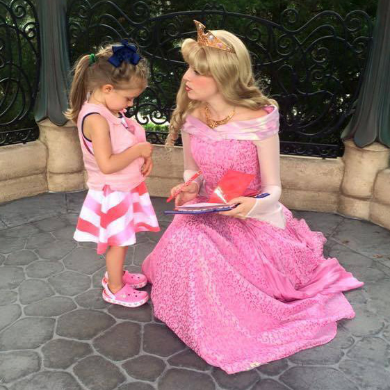 Girl wearing pink kool max toddler cooling vest talking to a disney princess